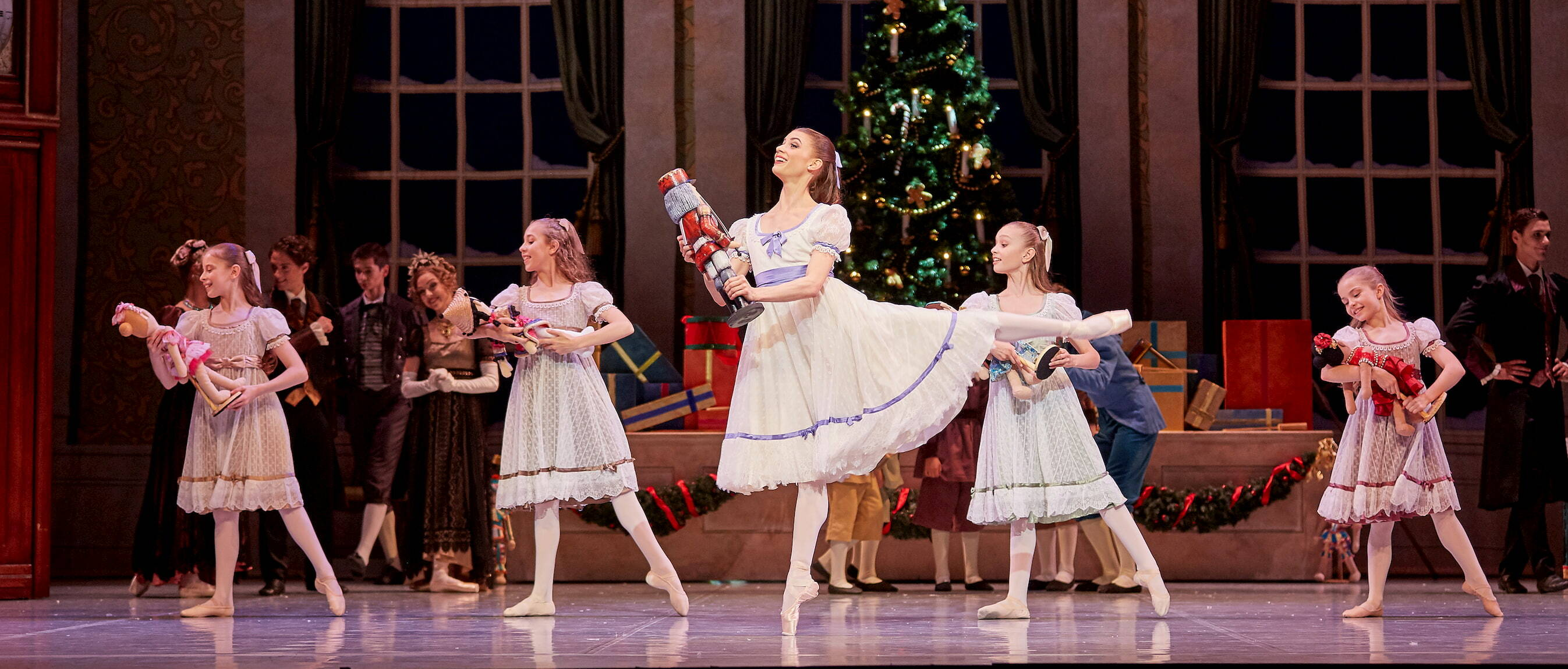 Carina Roberts as Clara with Child Guest Artists in The Nutcracker. Photo by Sergey Pevnev